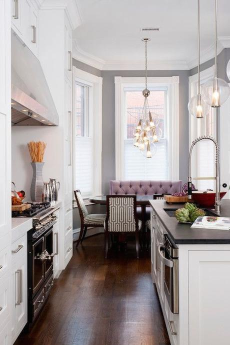 It's a little tricky to see what's happening here, but I believe the lower half of the windows have either a cellular shade or window film on them. So you can still see outside but you get privacy too. This idea could work for the kitchen banquette.: