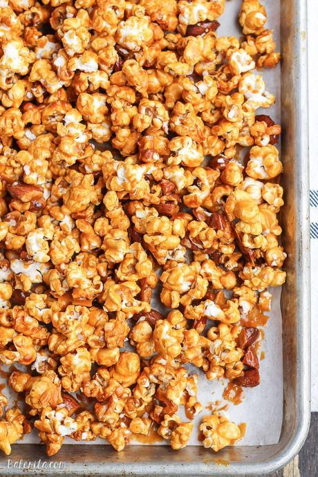 This Salted Honey Almond Caramel Corn is an addictive snack you can give as a gift or serve to a crowd. This caramel corn is made without corn-syrup and uses honey instead - it also has a sprinkle of sea salt!