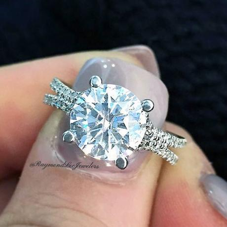 round brilliant solitaire on a split shank pave band