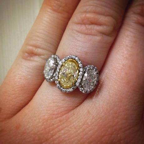 Fancy yellow oval halo engagement ring