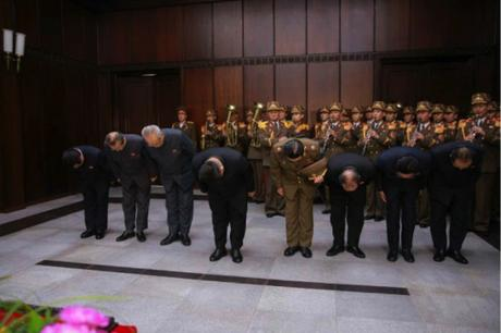 Kim Jong Un (center) and members of the WPK Secretariat bow in front of a casket containing Kim Yang Gon's body at a funeral parlor at Sojang Club in Pyongyang on December 30, 2015 (Photo: Rodong Sinmun).