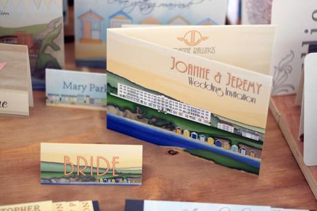 Large bifold wedding invitation and place name showing Saunton Sands Hotel in Devon.