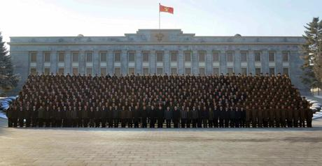 Kim Jong Un poses for a commemorative photograph with senior managers and personnel involved in the DPRK's fourth nuclear test (Photo: Rodong Sinmun).