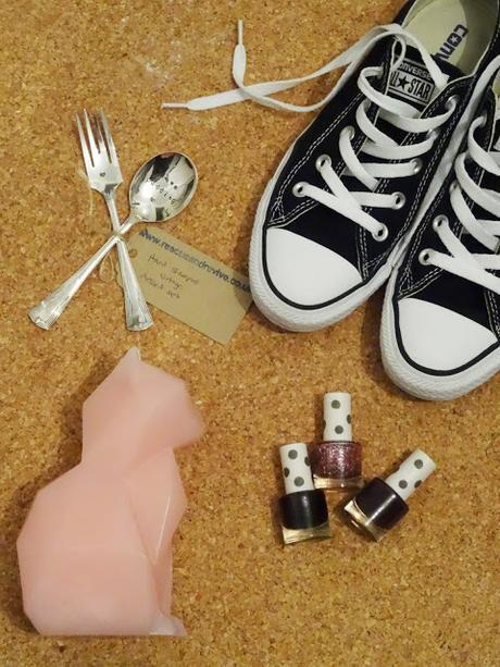 love pudding spoon, pair of converse, three Topshop Nail varnish and a Cat candle
