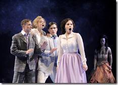 Hermia (Christina Nieves, right) is outraged by the insults launched at her by (l-r) Demetrius (Matt Schwader), Helena (Laura Huizenga) and Lysander (Andrew Truschinski), while Oberon (Timothy Edward Kane) observes the chaos his magic has created, in CST Associate Artistic Director Gary Griffin's production of William Shakespeare's A Midsummer Night's Dream, now playing at Chicago Shakespeare Theater. (photo credit: Liz Lauren)