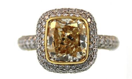 3.01 carat fancy yellow Si1 cushion cut diamond in platinum