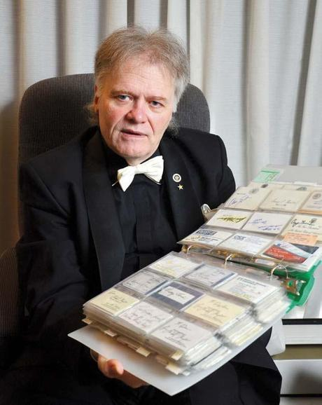 Quite a collection: P. M. (Doc) Koepfer shows off some of the business cards in is collection of 80,000. He's been collecting business cards since the age of six.