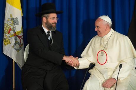 Pope Francis hides crucifix