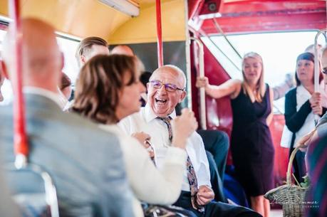 Father of the bride enjoying a joke on the bus