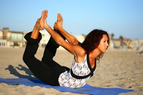 Dhanurasana - Bow pose in yoga exercise