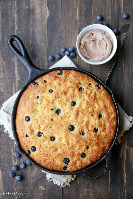 This Blueberry Cornbread is a sweeter take on traditional cornbread with fresh blueberries and sweet corn kernels. It's baked in a skillet and served with whipped cinnamon honey butter.
