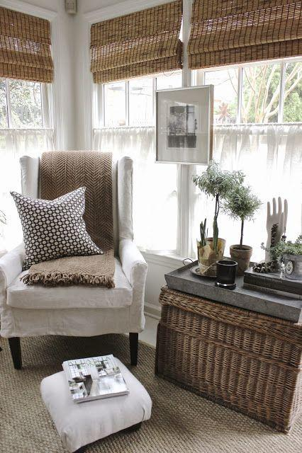 Love the wicker basket, galvanized tray and the blinds. Interesting way to hang frame - on the trim between windows.: