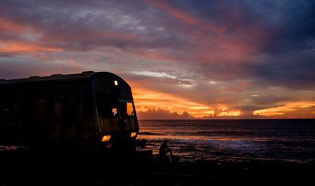 One of the best sunsets we saw, completely with moving train and a lone person staring at the sun, award winner!
