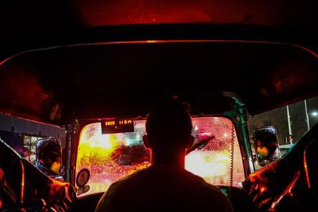 A 3-wheeler ride home on a very rainy evening. The brake lights lit up the entire inside of the 3-wheeler. This was the day of my ebook release, fittingly the 3-wheeler looks like a nightclub! Fujifilm X-Pro2.