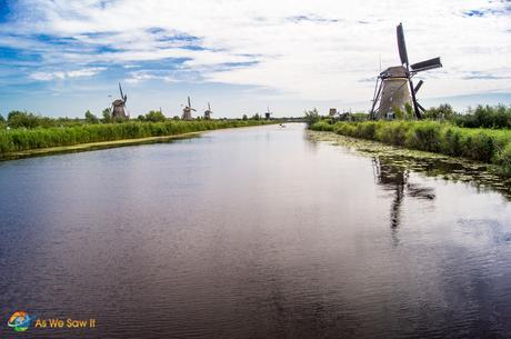 Flat lands and canals that the windmills control.