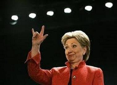 Hillary makes devil sign