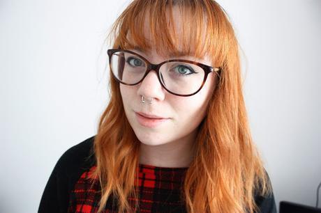 Max&Co glasses close up with raglan tartan jumper