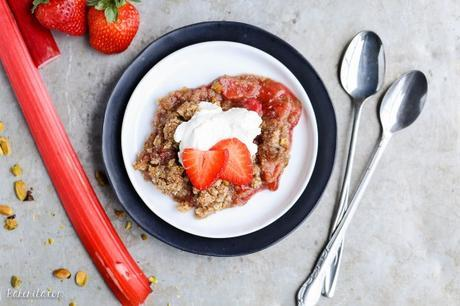 This Strawberry Rhubarb Crisp combines tart rhubarb and sweet strawberries, topped with a pistachio crumble topping! This crisp is Paleo-friendly, gluten-free, and vegan.