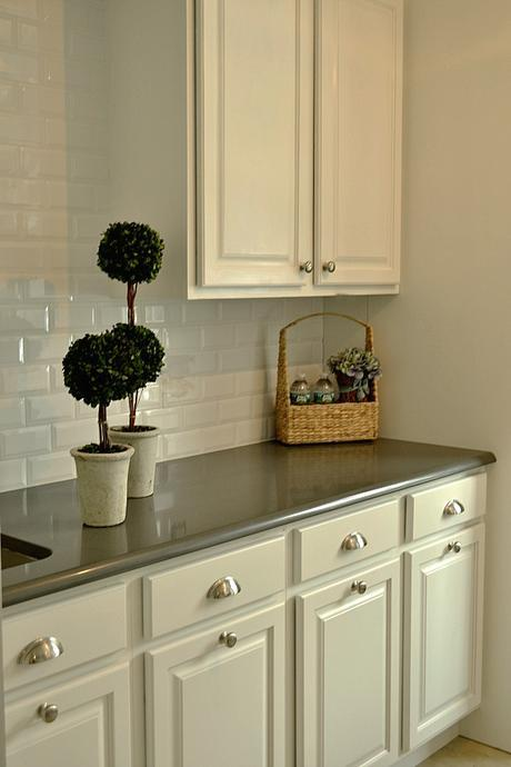 painted white laundry room cabinets