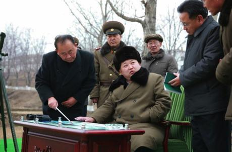 Kim Jong Un is briefed about the missile warhead simulation.  In attendance are WPK Senior Deputy Director Ri Pyong Chol (left) and WPK Munitions (Machine-Building)Industry Department deputy director and ballistic missile expert Kim Jong Sik (2nd right) (Photo: Rodong Sinmun).