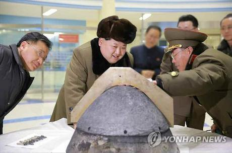 Kim Jong Un is briefed during a reentry simulation for a ballistic rocket.  Seen in attendance are WPK Munitions Industry (Machine-Building Industry) Deputy Director Kim Jong Sik (left) and KPA Strategic Force Commanding Officer, General Kim Rak Gyom (right) (Photo: KCNA-Yonhap).