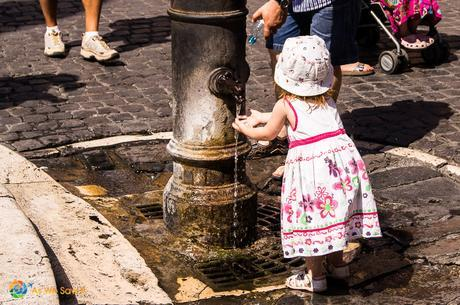 Little girl washing her hands outside the Pantheon