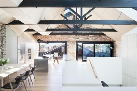 Renovated warehouse with exposed structure and ample skylights.