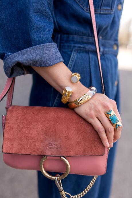how to wear a denim jumpsuit, julie vos baroque bracelet, wishing well intentions acacia ring, alexis bittar lucite gold bracelet, rose pink chloe faye bag