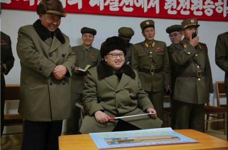 Kim Jong Un observes a solid fuel rocket engine test and cascade separation.  Also in attendance, left, is Senior Deputy Director of the WPK Organization Guidance Department Ri Pyong Chol (Photo: Rodong Sinmun).