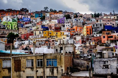 Steep hills and colourful houses of Guanajuato, captured by me standing on my toes, reaching over a tall wall to get this view!