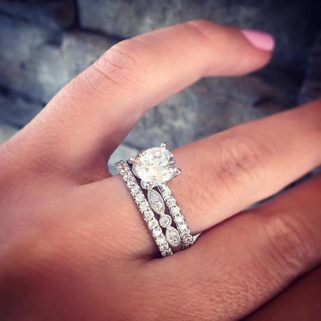A stunning solitaire engagement ring stacked with two wedding bands, or one wedding band and one promise ring, depending on how great your high school boyfriend was.