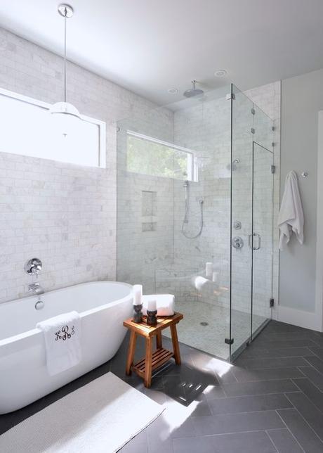 White bathroom, free standing tub, monogrammed towel, gray floor tile, glass shower, pendant lighting above tub | Lilli Design: