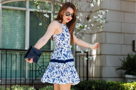 Dallas Blogger, Amy Havins, wears a blue and white Shoshanna Floral print dress.