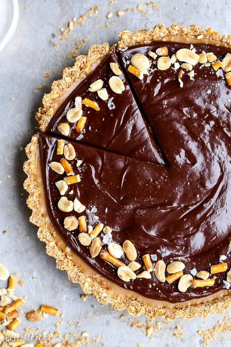 This Chocolate Peanut Butter Tart has a crunchy pretzel crust and smooth peanut butter caramel filling, all topped with luscious chocolate ganache. This recipe is gluten-free and vegan.