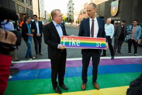 Seattle Mayor Ed Murray (l) standing on a rainbow sidewalk that will fight crime.