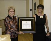 Jane Lubchenco receiving the Pauling Legacy Award certificate from Faye Chadwell, University Librarian and Director of the OSU Press.