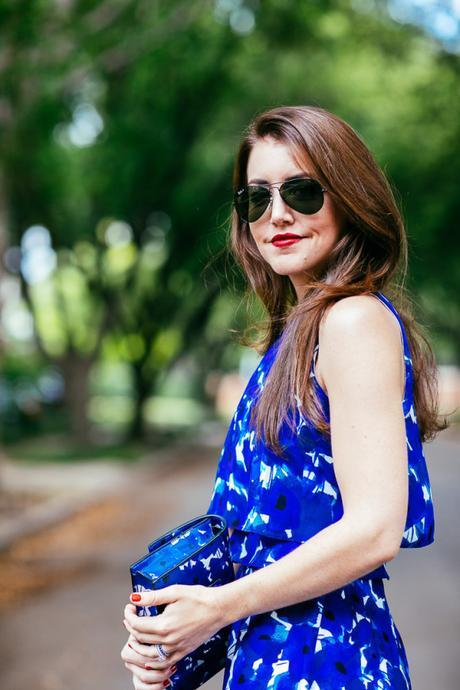 Dallas Blogger, Amy Havins, wears a blue floral print Ivanka trump a-line dress.