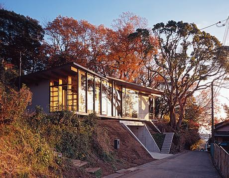 Modern Japanese hilltop home facade steel framed doors and windows