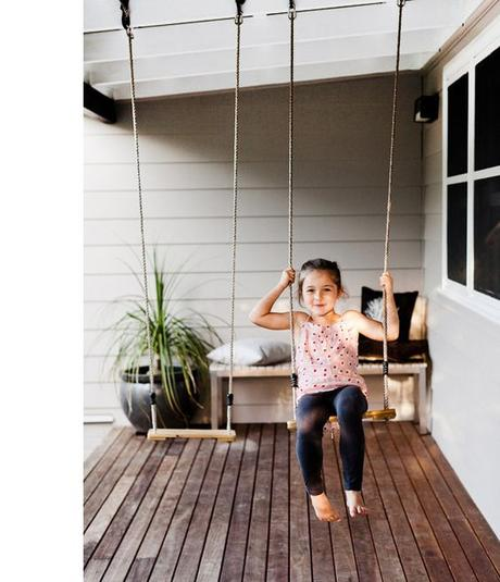Swings on front porch. Great idea, kids can get out and play even when it's raining.: