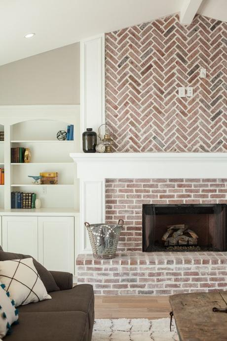Fireplace with herringbone pattern brick work and built in shelving - by Rafterhouse.: