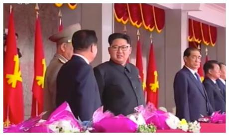 Kim Jong Un talks with WPK Political Bureau Presidium Members, KPA General Political Department Director Vice Marshal Hwang Pyong So (partially obscured) and WPK Vice Chairman for Workers' and Social Organizations Choe Ryong Hae (Photo: Korean Central Television).