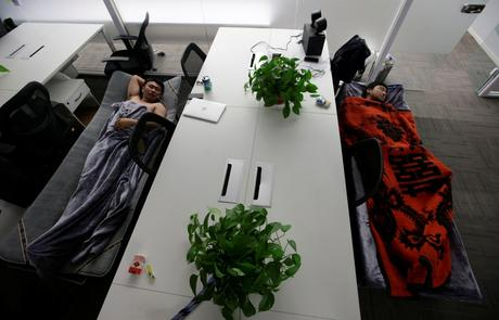 Some employees at RenRen Credit Management Co. sleep on provided camp beds in their office.