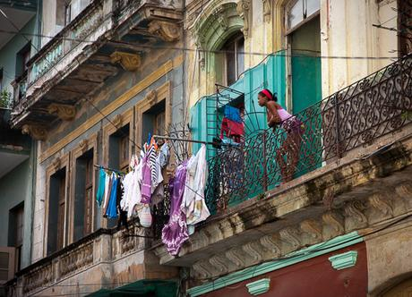 Woman on balcony in Havana, Cuba