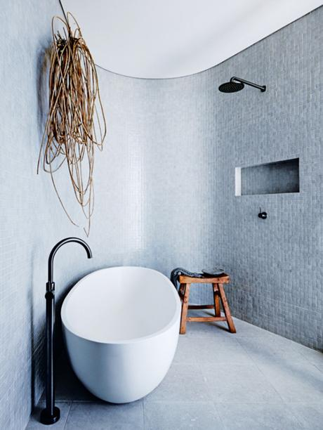 Eclectic beach home in Sydney. Freestanding bathtub. Photo by Anson Smart via Vogue Living