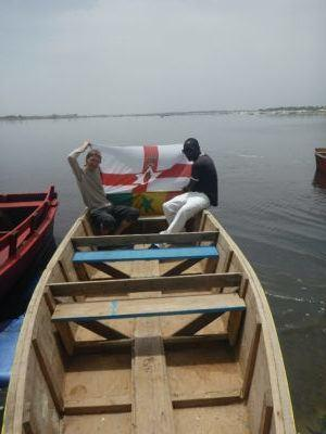 Northern Ireland and Senegal flags on Lac Rose