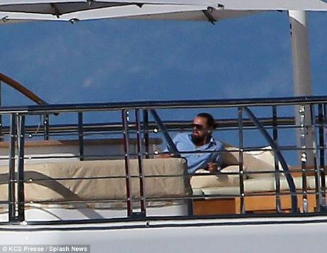 Leo on a vacay aboard a super energy guzzling yacht