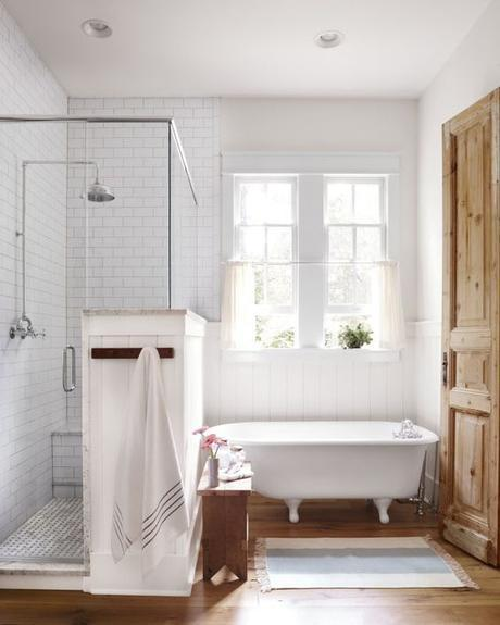 A refurbished 1930s claw-foot bathtub (Appalachian Tubs, 770-324-8701) is a quaint spot to soak in the suds and the sunshine. It's also the perfect country counterpoint to the modern walk-in shower.: