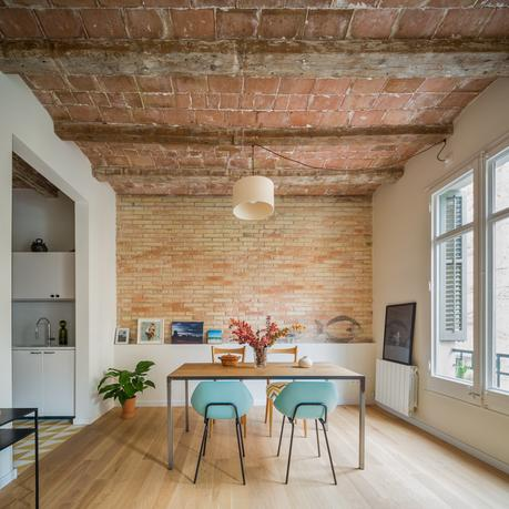 Barcelona apartment with a historic chamfered ceiling