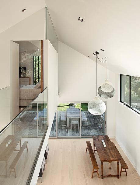 New Zealand home has double height ceiling with Moooi pendant lamps above the dining area