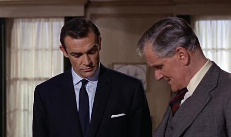 Note the lighter shade of navy in Bond's tie compared to the rest of his suit.
